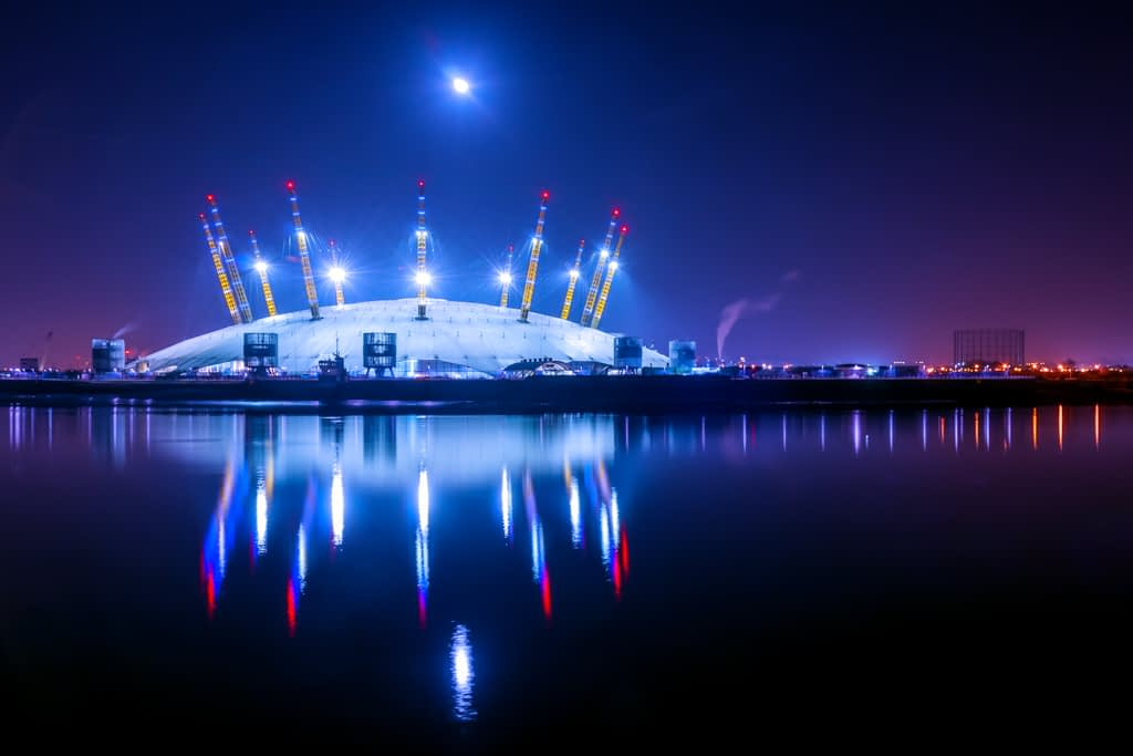 Long exposure night photography of the O2 Arena from across the Thames River