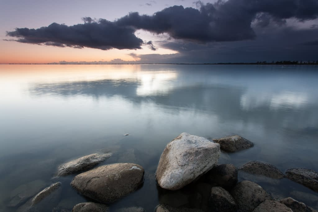 A landscape photograph showing the calm waters of the IJsselmeer in Holland.