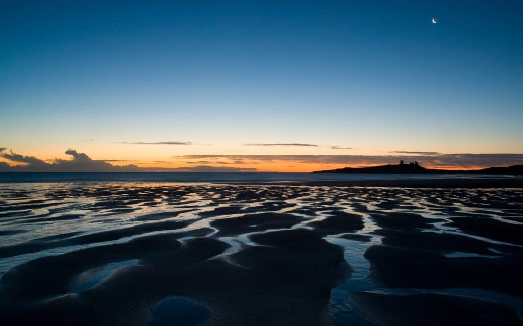 A landscape photograph of sunset over Embleton Bay, UK.