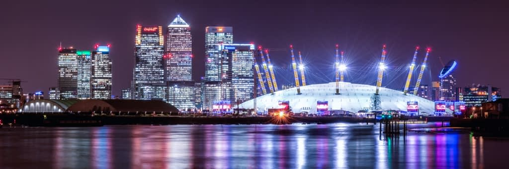 Long exposure night photography of the O2 Arena with Canary Wharf in the background