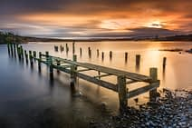 Afterglow - A landscape photograph of a broken down jetty in Northern Ireland.