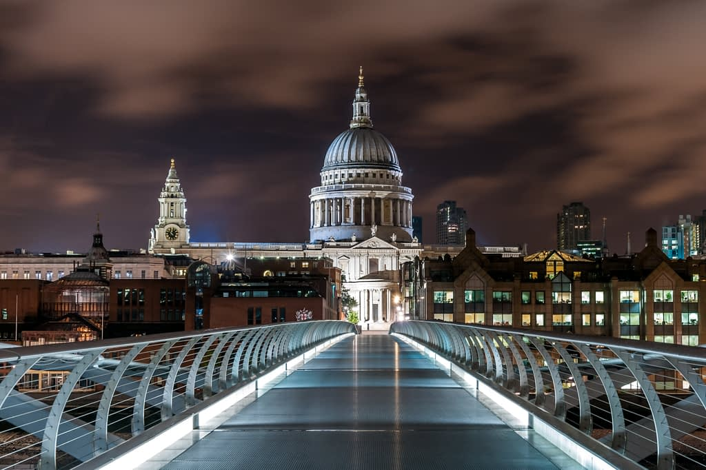 A nightscape of the Millennium Bridge with Saint Paul's Cathedral in the background